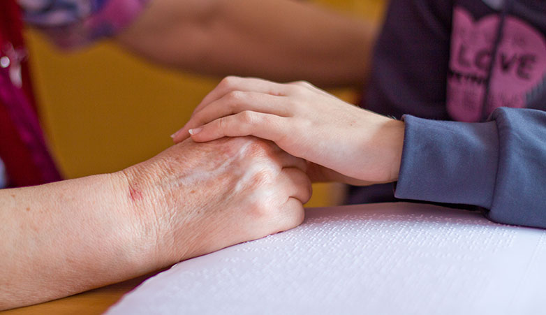 Holding hands | Simcoe Community Services