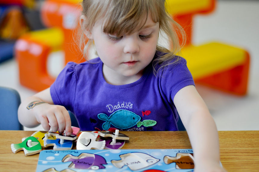 Child Playing with a fish puzzle | Simcoe Community Services