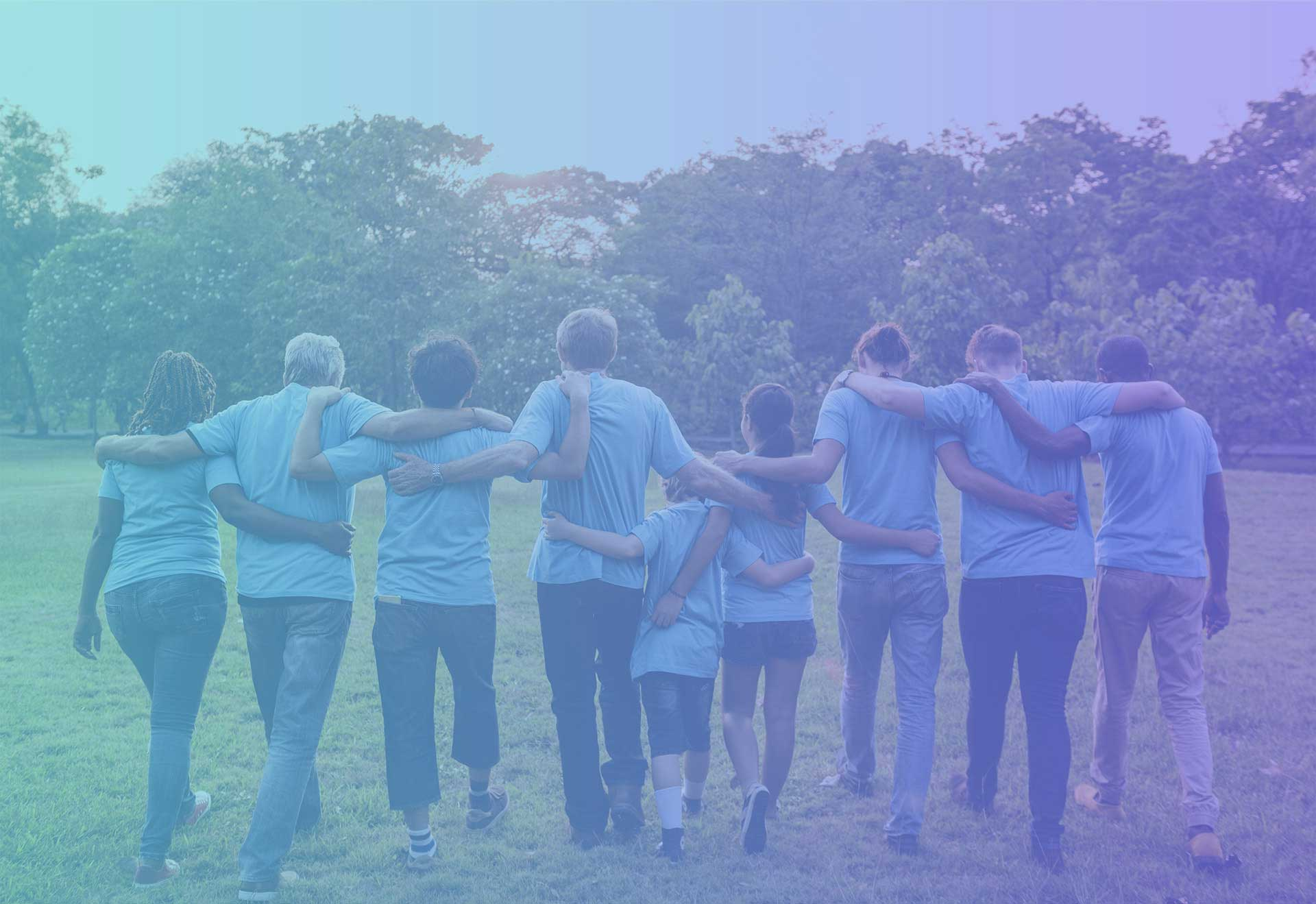 Group in blue shirts walking together | What's New? | Simcoe Community Services