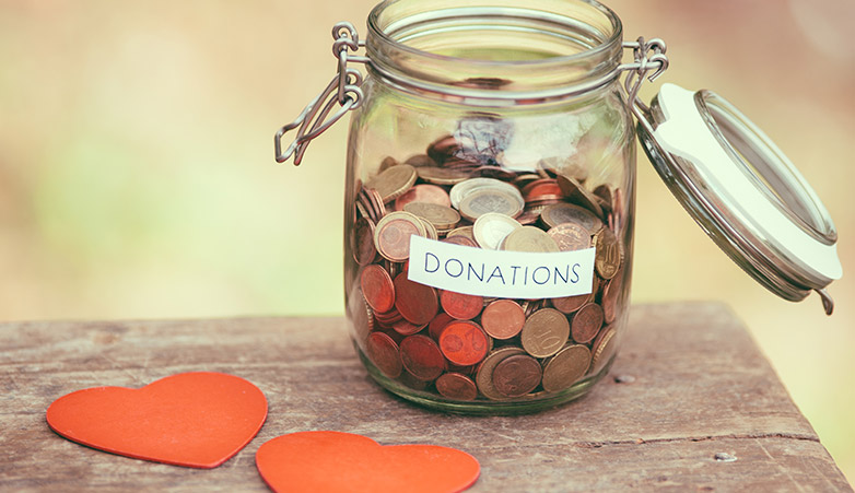 Donation jar filled with change | Simcoe Community Services