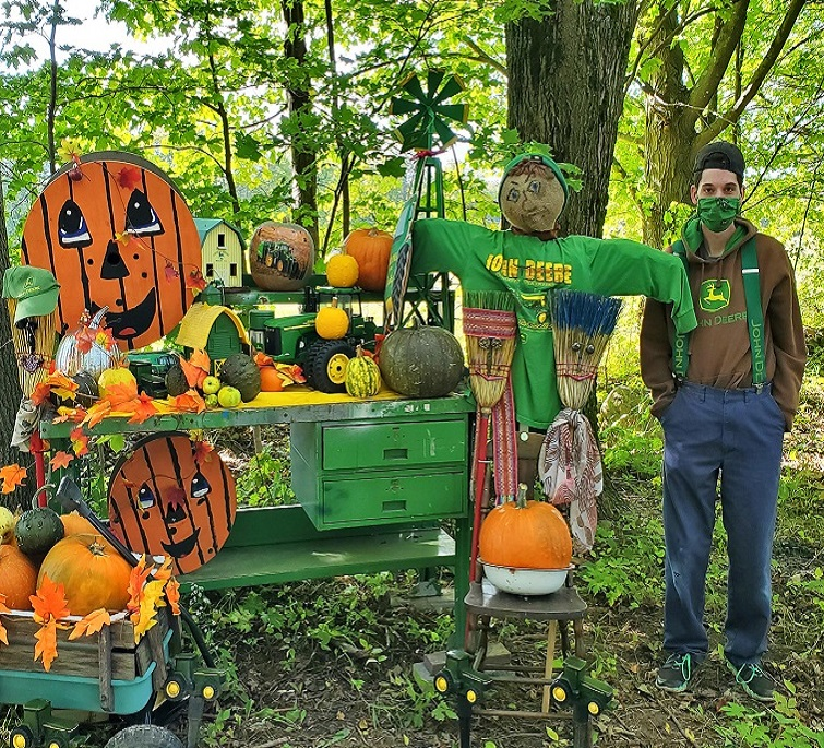 Person supported pumpkin display