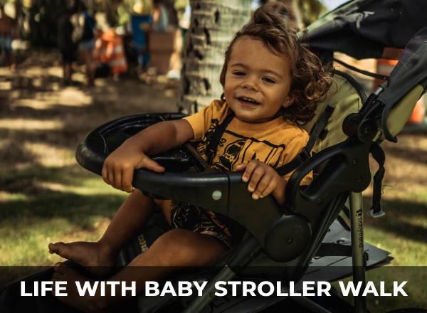 toddler in stroller smiling