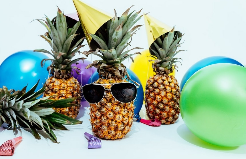 pineapples with sunglasses and balloons